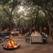 Dulini River Lodge, Boma Dinning Area with campfire